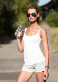 Fitness woman drinking water. After running Stock Images