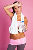 Fitness Woman Drinking Water. Wiping brow Royalty Free Stock Photos