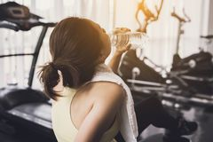 Fitness woman drinking water after work out Royalty Free Stock Photos