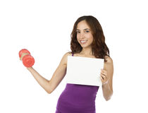 Fitness woman with a dumbbell holding an advertisement board Stock Images