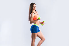 Fitness woman with dumbbell. Royalty Free Stock Image