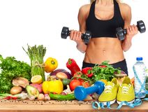 Fitness woman with dumbbells stock photography