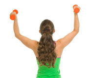 Fitness woman with dumbbells rejoicing success Royalty Free Stock Image