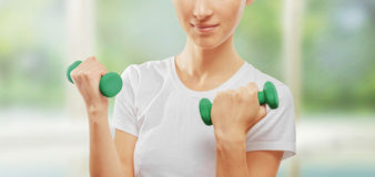 Fitness woman with dumbbells Stock Photos