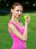 Fitness woman eating apple Stock Image