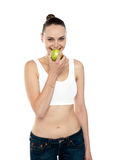 Fitness woman eating green apple Stock Photography