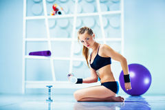 Fitness woman with equipment Royalty Free Stock Images