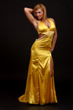 Fitness woman in evening-dress. Fitness woman posing in evening- dress Royalty Free Stock Image