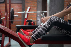 Fitness woman executed exercise with exercise-machine Cable Crossover at fitness center. Stock Photography