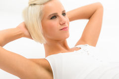 Fitness woman exercise abs sit-ups on white Royalty Free Stock Image