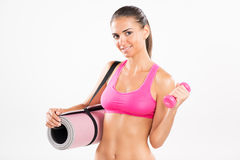 Fitness woman with exercise mat and dumbbells Stock Image