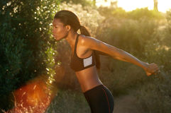 Fitness woman exercise stretching outside Royalty Free Stock Photo