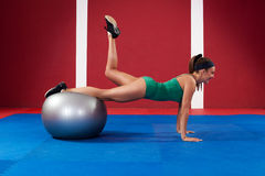 Fitness woman exercising with ball Royalty Free Stock Images
