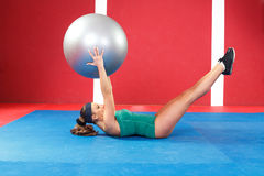 Fitness woman exercising with ball Stock Photography