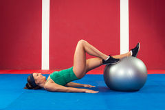 Fitness woman exercising with ball Royalty Free Stock Image