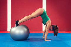 Fitness woman exercising with ball Stock Photos