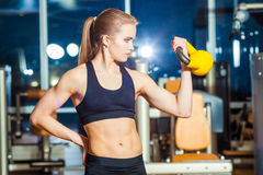 Fitness woman exercising crossfit holding Stock Images