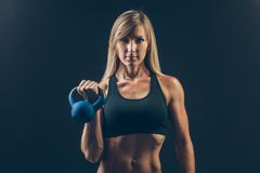 Fitness woman exercising crossfit holding Royalty Free Stock Photo