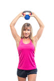 Fitness woman exercising crossfit holding Stock Image