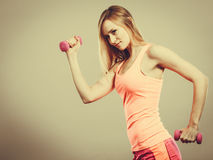 Fitness woman exercising with dumbbells. Royalty Free Stock Photos