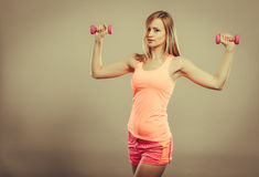 Fitness woman exercising with dumbbells. Stock Images