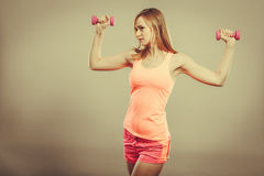 Fitness woman exercising with dumbbells. Royalty Free Stock Image