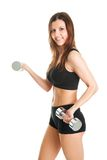 Fitness woman exercising with dumpbells Royalty Free Stock Images