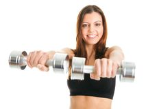 Fitness woman exercising with dumpbells Royalty Free Stock Photos