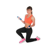 Fitness woman exercising with dumpbells Stock Images