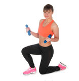 Fitness woman exercising with dumpbells royalty free stock image