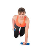 Fitness woman exercising with dumpbells Stock Photo