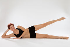 Fitness woman exercising with her legs Royalty Free Stock Photo
