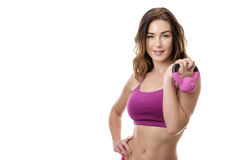 Fitness woman exercising holding kettlebell Royalty Free Stock Image