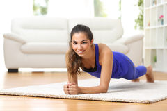 Fitness woman exercising at home Royalty Free Stock Photos