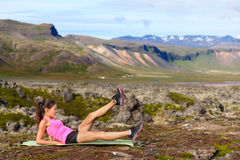 Fitness woman exercising in nature Stock Photography