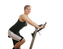 Fitness woman exercising on spinning bicycle Royalty Free Stock Photo