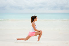 Fitness woman exercising and stretching Royalty Free Stock Image