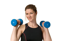 Fitness Woman Exercising w/ Weightlifting Dumbells. Beautiful Fitness Woman Exercising w/ Weightlifting Dumbell hand weights isolated on white background Royalty Free Stock Image