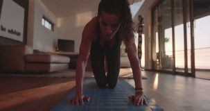 Fitness woman exercisng at home stock footage