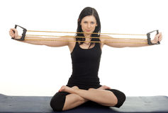 Fitness woman with expander Stock Images