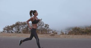Fitness woman finishing her run stock footage