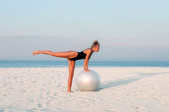 Fitness woman with fit ball on beach outdoors. Royalty Free Stock Photography