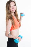 Fitness woman. Fit fitness girl smiling happy lifting weights Stock Photos
