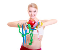 Fitness woman fit girl holding colorful measure tapes fruit Royalty Free Stock Photo