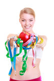 Fitness woman fit girl holding colorful measure tapes fruit Stock Images