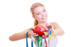 Fitness woman fit girl holding colorful measure tapes fruit Royalty Free Stock Images