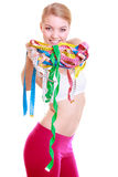 Fitness woman fit girl holding a lot of colorful measure tapes Royalty Free Stock Photo