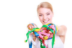 Fitness woman fit girl holding a lot of colorful measure tapes Stock Image