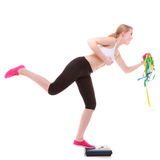 Fitness woman fit girl holding measure tapes on scale royalty free stock images