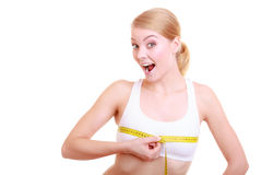 Fitness woman fit girl with measure tape measuring her bust. Time for diet slimming weight loss. Health care and healthy nutrition. Young fitness woman fit girl Royalty Free Stock Images